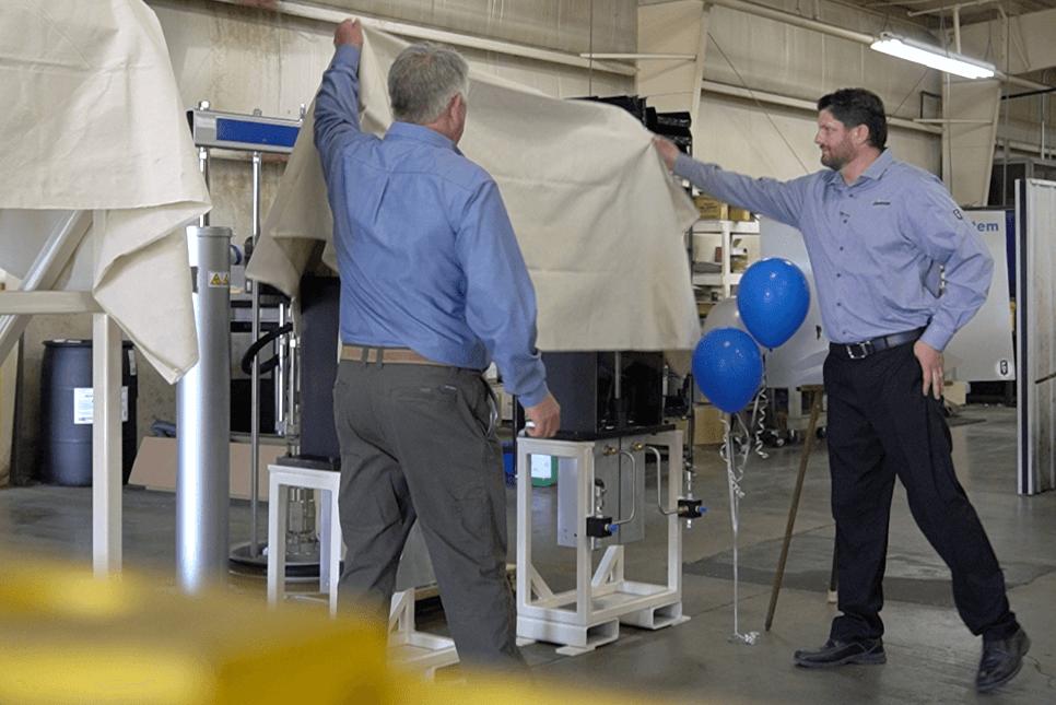two employees revealing Precision Dispense Technologies