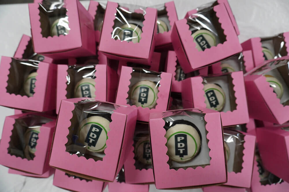 PDT promotional items in pink boxes