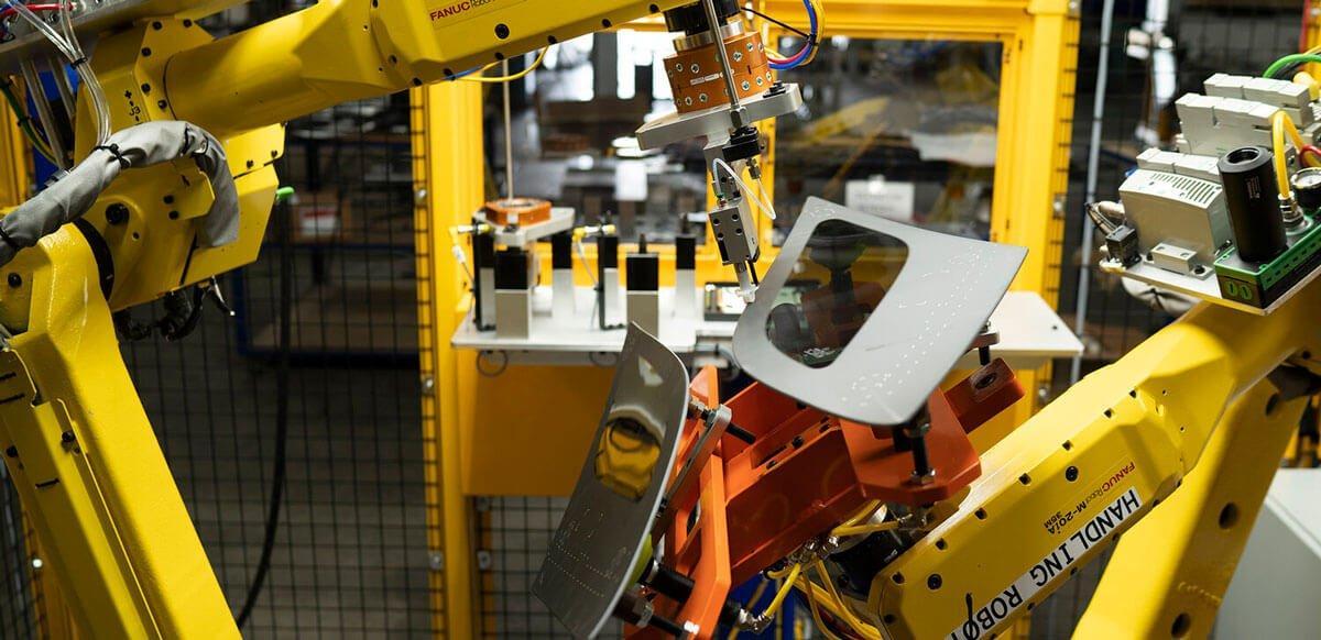 hil-man automation robot holding side windows